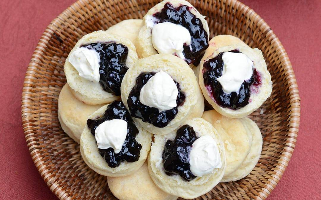 Scones with cream and jam ontop