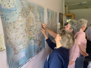 two women looking at map of australia on the wall