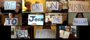 Zoom meeting with people holding up signs