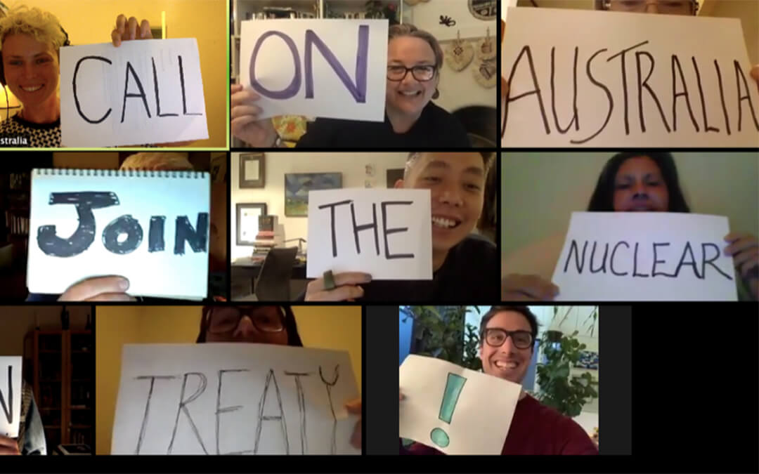 Grid of people holding up signs on computer