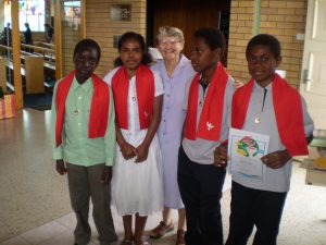Catholic religious nun with people from PNG
