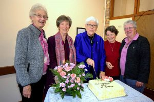 Five women around a cake