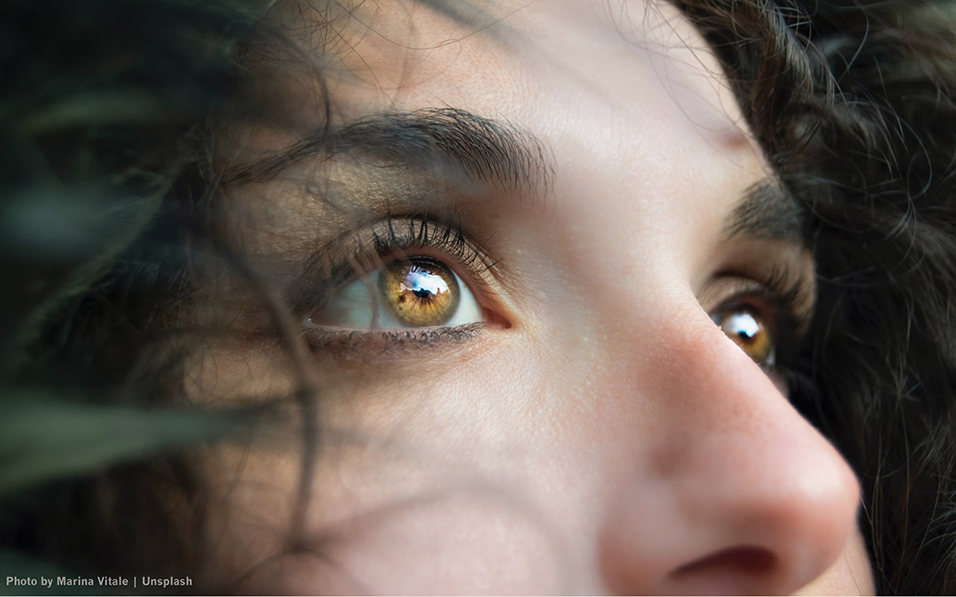 Close up of woman's eyes looking into distance